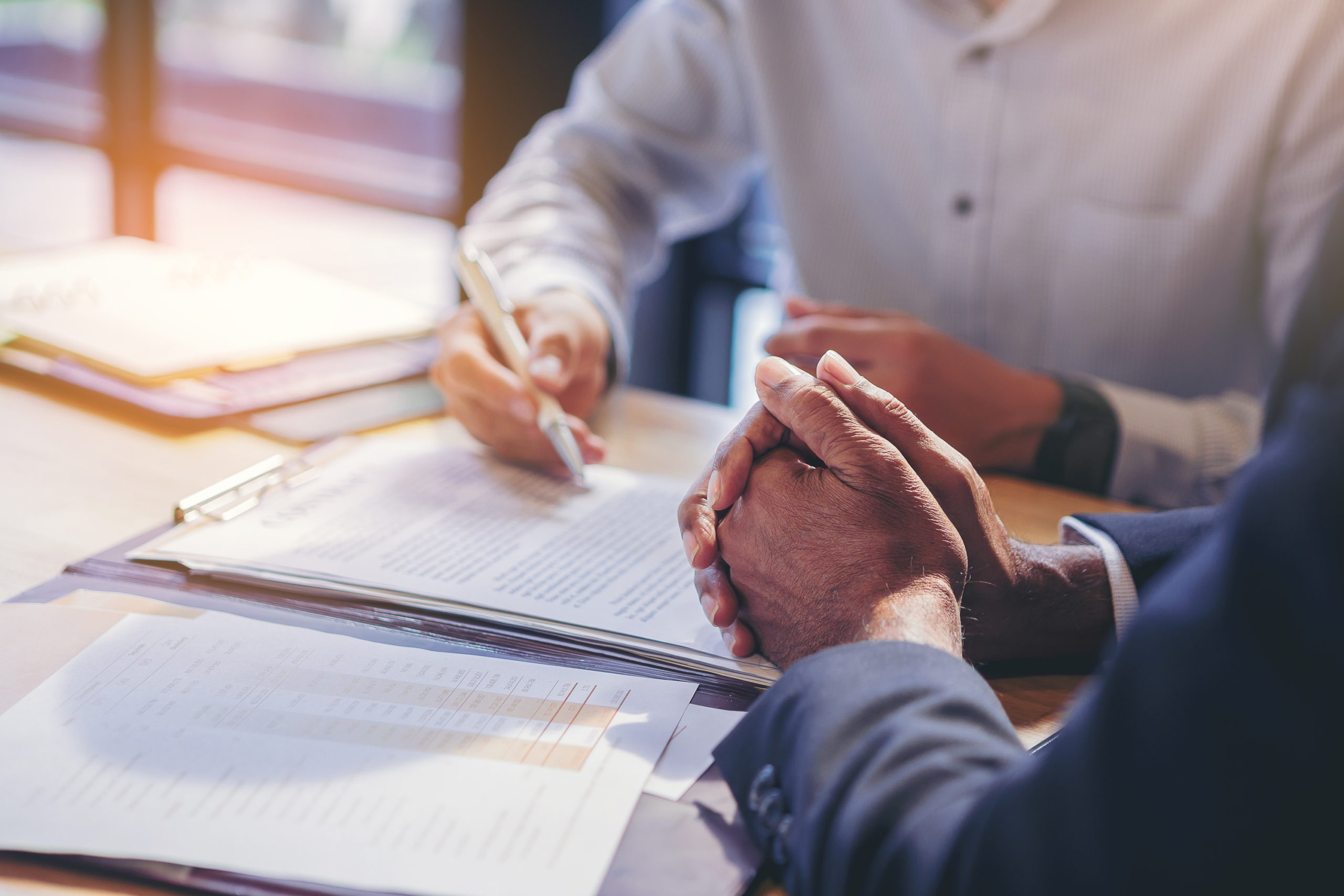 demand letters for breach of contract concept.businessman reading documents at meeting, business partner considering contract terms before signing checking legal contract law conditions