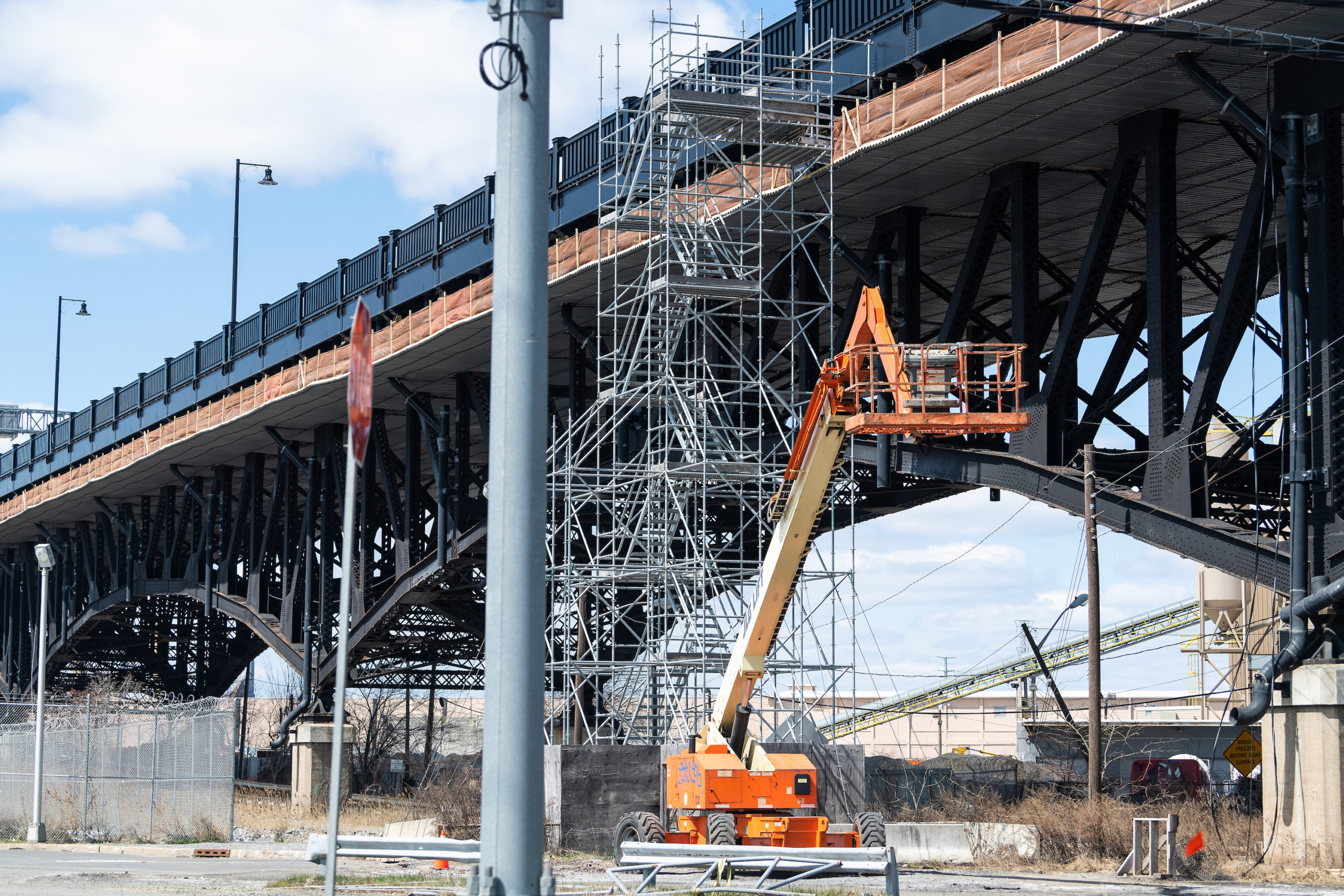 construction lien concept Jersey City, USA - April 6, 2018: Industrial view in downtown city area in New Jersey with construction on bridge